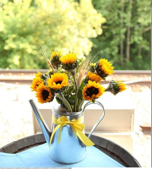 wedding sunflowers costco ikea diy Sunflower Centerpiece.    Watering cans as centerpieces!
