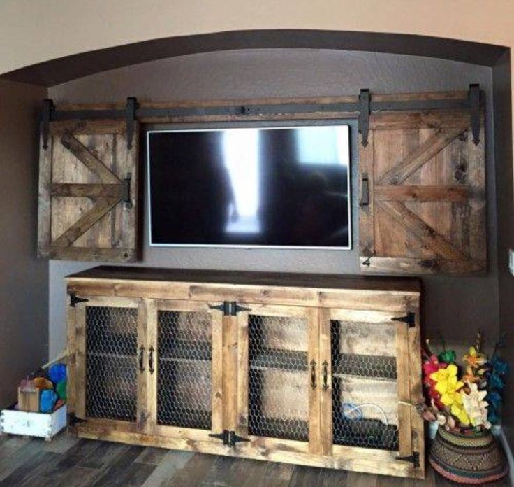 How fun to build a sliding barn wood door to cover your flatscreen TV. An idea