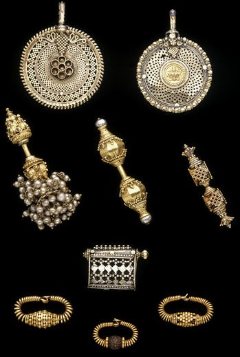 Collection of ear ornaments from India and Sir Lanka at the Victoria & Albert Museum. Predominately gold. The pieces date between 1870 - 1885