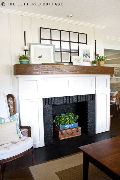 love this mantle. the colors and wood and greenery.