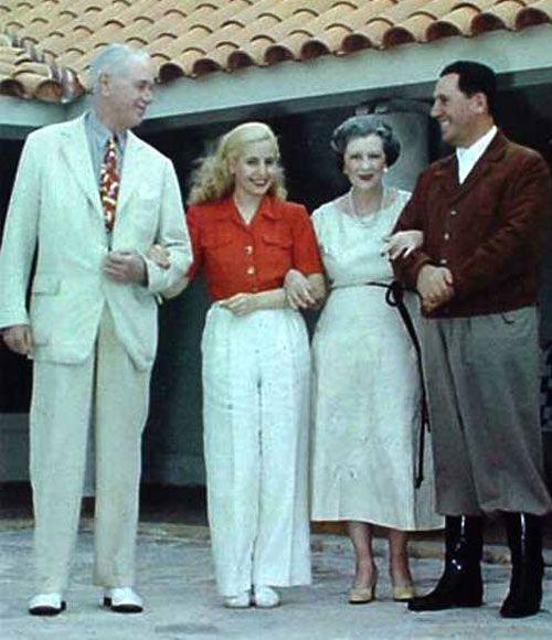 Eva Peron white high waisted wide legged pants red blouse