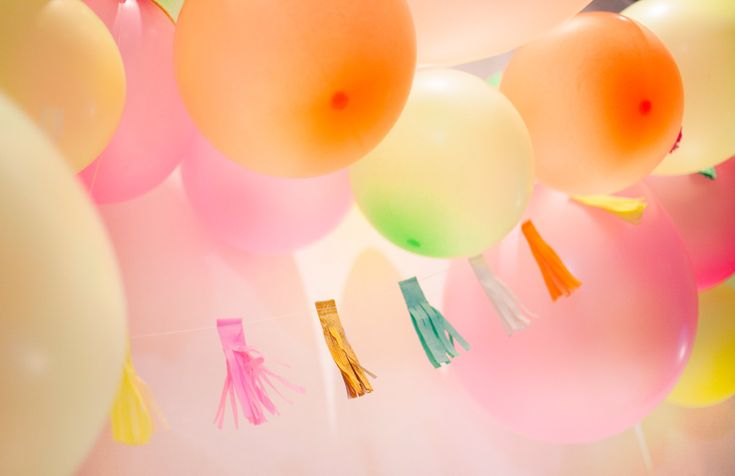 Stunning bright neon balloons strung together to form a beautiful balloon garland. Intertwined with a like colour tassel banner- so much fun!