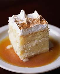 """Pastel de tres leches (from Spanish, """"three milks cake""""), or pan tres leches (""""three milks bread""""), is a sponge cake—in some recipes, a butter cake—soaked in three kinds of milk: evaporated milk, condensed milk, and whole milk.  When butter is not used, the Tres Leches is a very light cake, with many air bubbles. This distinct texture is why it does not have a soggy consistency, despite being soaked in a mixture of three types of milk."""