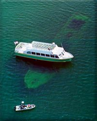 SHIPWRECK TOURS : MUNISING. Glass bottom boat narrated tours of Lake Superior shipwrecks and Lake Superior shipwreck diving. Discover shipwrecks of the Alger Underwater Preserve through the clear waters of Lake Superior. Two hour narrated tours describe the history of turn of the century wrecks.