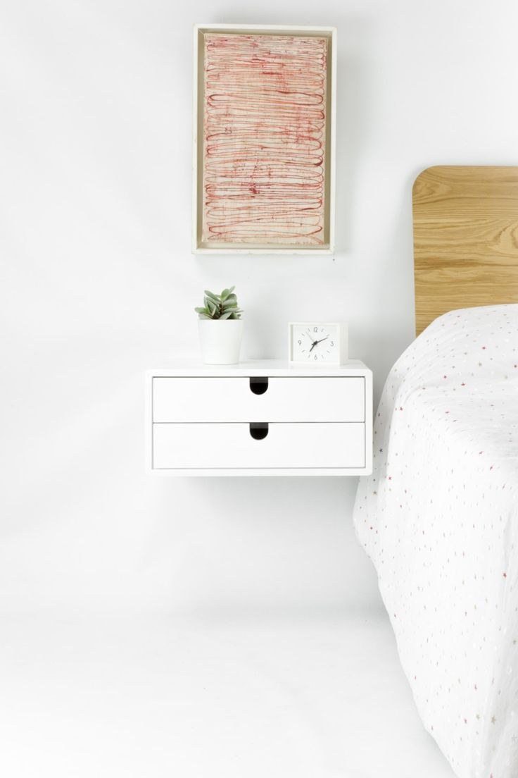 Sleek and contemporary solid wood hand crafted bedside table / nightstand floating drawer  The nightstand is designed to float on the wall, attached to the wall , it's a moderately easy install for someone with basic tools (drill, and a screwdriver)  A matte acrylic varnish is applied to the wo