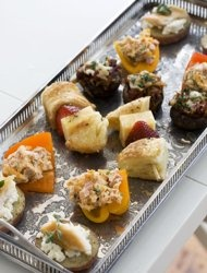 stuffed baby bell peppers, strawberry croissant skewers, and chorizo hash stuffed mushroom caps,