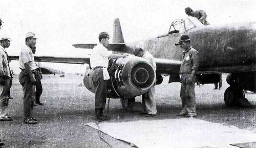 Japanese mechanics perform maintenance on one of the jet engines of a Nakajima Kikka (orange blossom) fighter-bomber. The Kikka was the first Japanese jet aircraft and the design borrowed heavily from the German Me 262 jet fighter, which had been shown to the Japanese military attaché in Germany a year earlier. Only one prototype had flown by the wars end. Japan. 7th of August 1945.