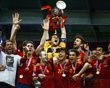 Spain's Casillas lifts up the trophy after defeating Italy to win the Euro 2012 final soccer match at the Olympic stadium in Kiev