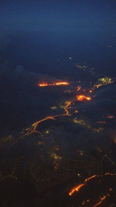A picture provided by Twitter user @TechDeckSafety shows the wildfire seen from an airplane leaving Fort McMurray on Wed, May 4, 2016.