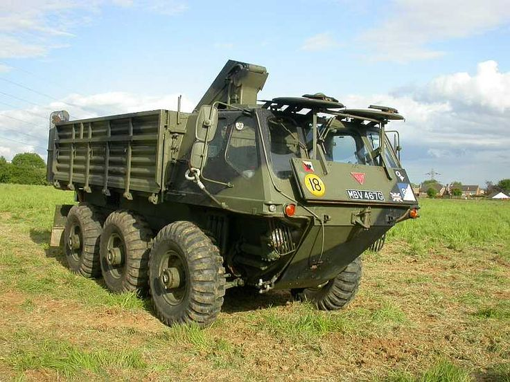 It's a British military vehicle, an Alvis Stalwart, 6wd amphibious truck, built in crane, 4 wheel steering.
