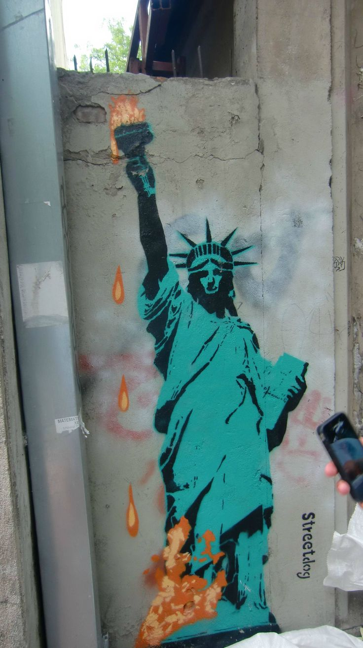 I don't particularly like the symbolism of this, but it's definitely powerful.  Street art