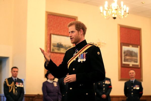 Prince Harry Photos Photos - Prince Harry presents the Firmin Sword of Peace to the Royal Air Force Police during an official visit to RAF Honington at RAF Honington on July 20, 2017 in Bury St Edmunds, England. - Prince Harry Visits Suffolk