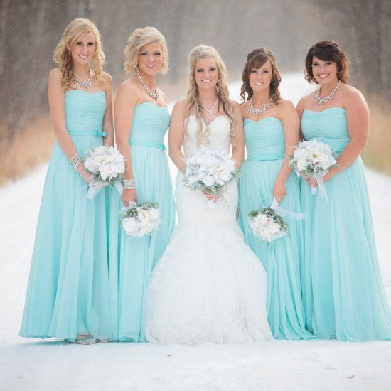 A Tiffany blue winter wedding on the first snow fall of the season in Alberta by Crown Photography.