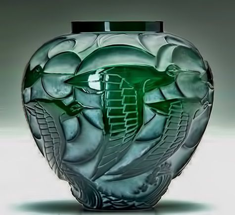 Rene Lalique Art Deco 'Courlis' vase, deep green glass with whitish patina, circa 1931.