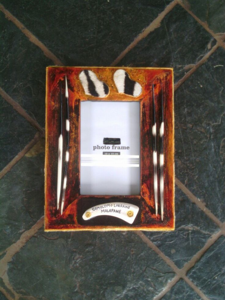 African themed picture frame by Alfred Dube.