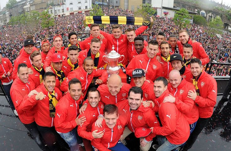 The Arsenal squad pose with the cup