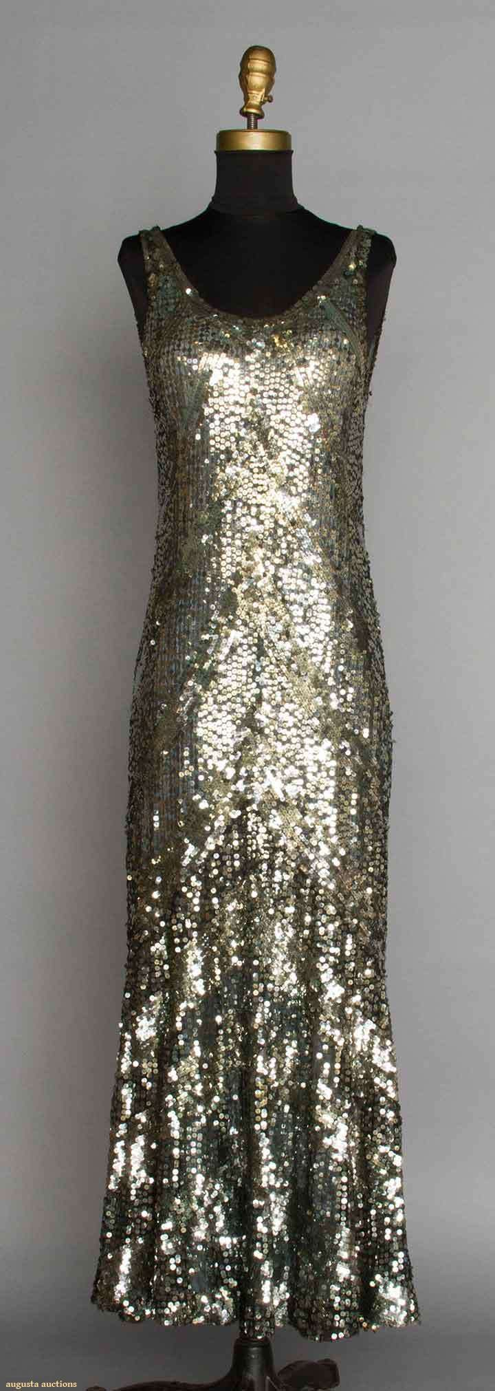 ~SILVER EVENING GOWN, 1930s~   Gown covered w/ silver sequins in chevron pattern, sleeveless, low back, low fluted skirt, blue-gray silk lining