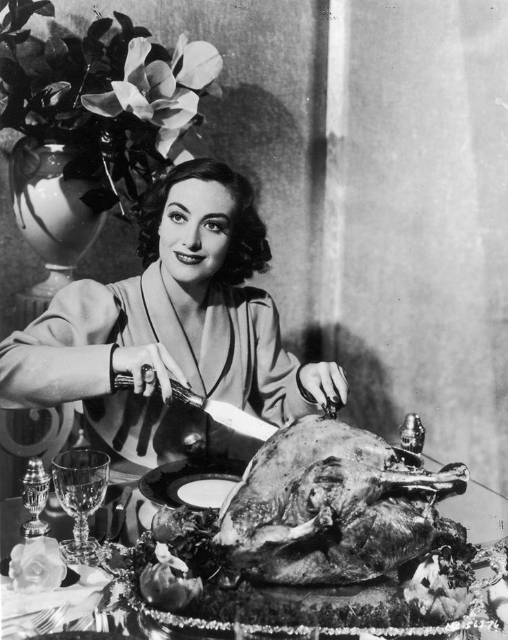 Joan Crawford carving the Thanksgiving Day Turkey.