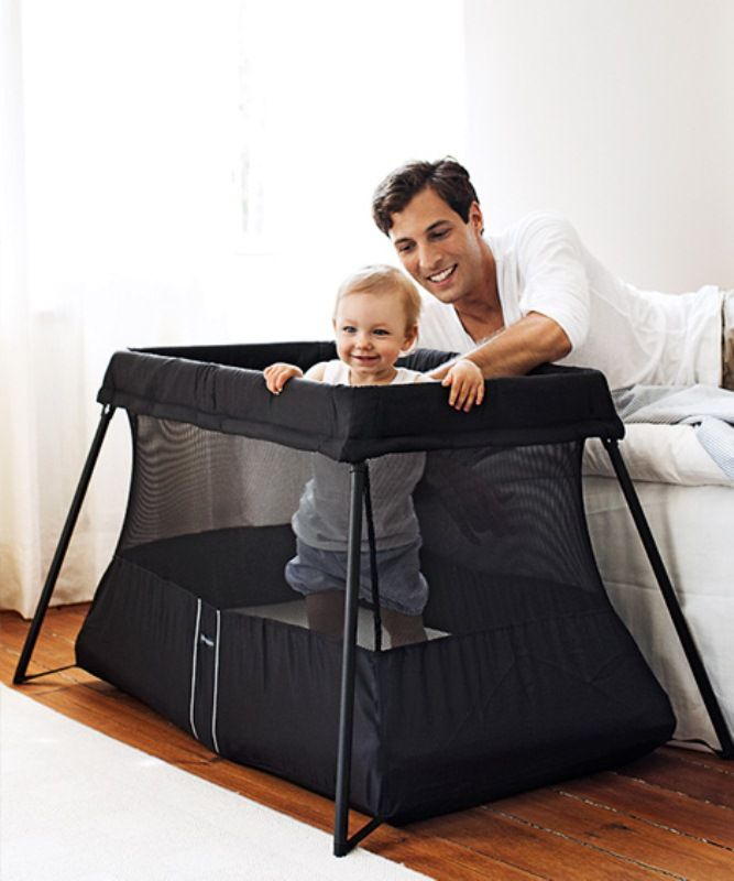 The   BabyBjorn   Travel Crib in Black Light and convenient to bring along.The BabyBjorn Travel Crib Light is the perfect crib to take with you on trips. It weighs only 11 pounds (5 kg) and is set up in one simple movement. It comes with a case that is as handy as an ordinary bag. Sleeping away from home with small children has never been easier