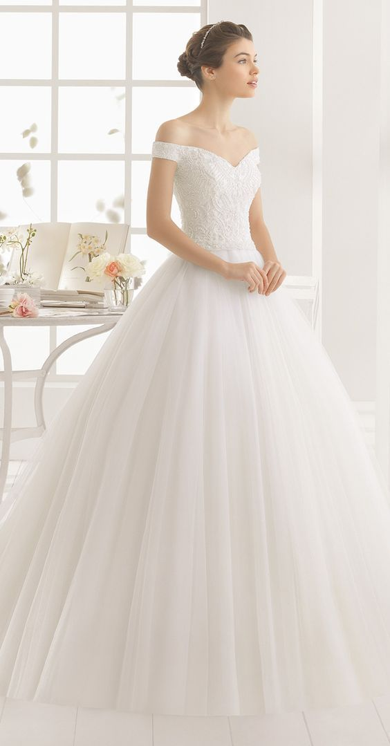 The 2017 Alfred Angelo Disney collection has hit the runway, and you'll weep when you see these stunning gowns that will make you a princess for your wedding day! #wedding #dress