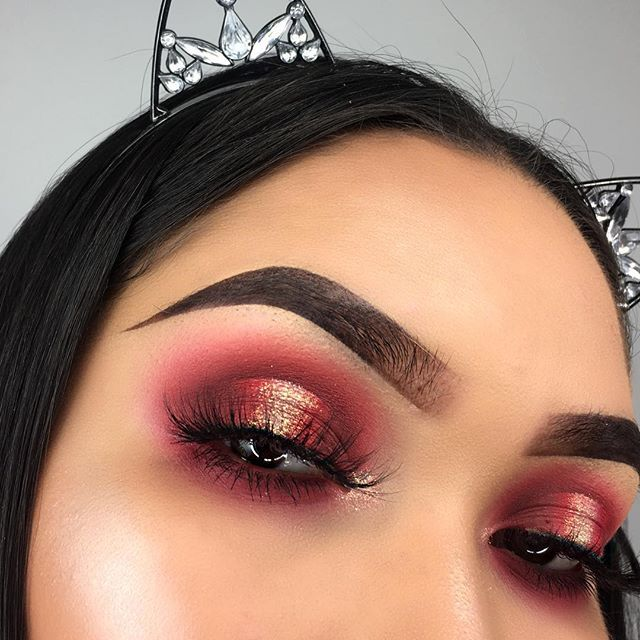 Raspberry red shadows with gold shimmer on the mid lid. Super dramatic look for prom or a night out.