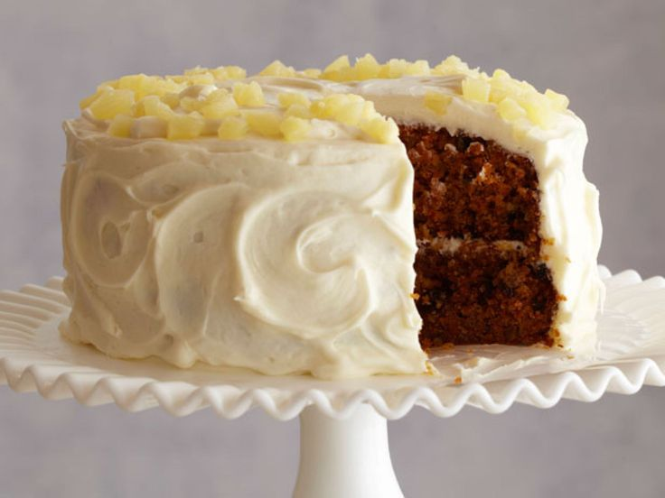 Carrot and Pineapple Cake : Ina folds shredded carrots and pineapple into a thick batter filled with raisins and walnuts. Cover the cake in a classic cream cheese frosting and top with diced fresh pineapple. After baking it, one reviewer said,