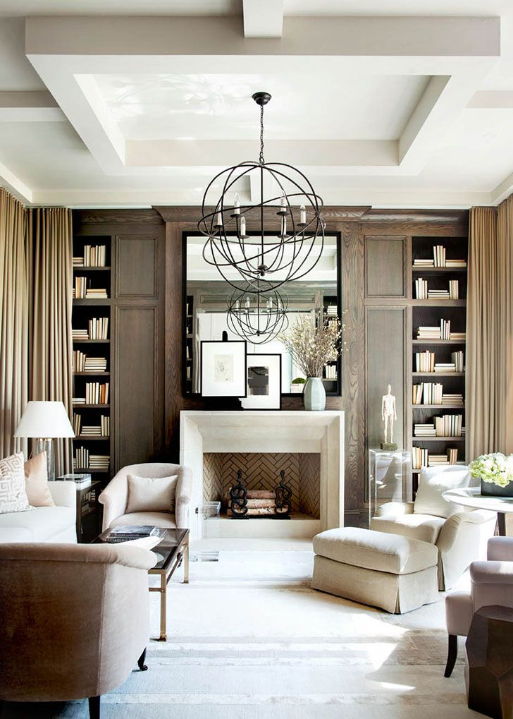 Wonderful! (see more) #classic #design #interior #style #decor #home #Living #room #idea #Inspiration #usa #american #modern #fireplace #books #library #mirror #chandelier #home #cozy #stylish #white #arm #chair