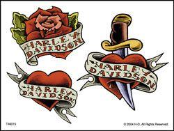 татуировка нож в сердце