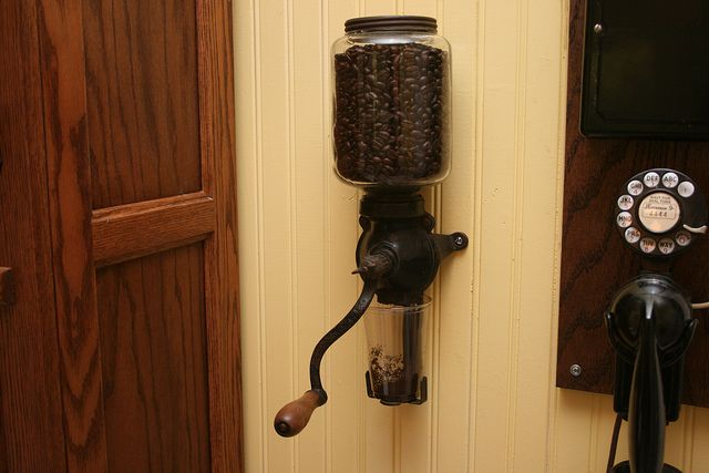 antique wall-mounted coffee grinder