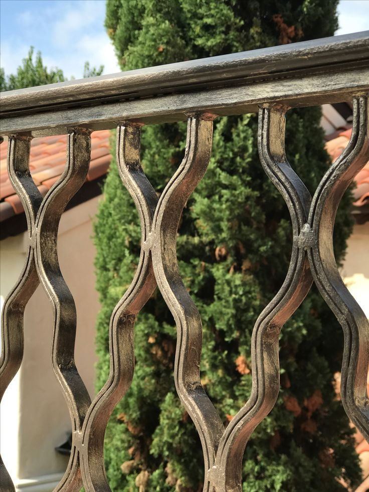 Don't forget the exterior of your home...this custom railing has a soft lustrous warm silver decorative paint finish added for perfect elegance.