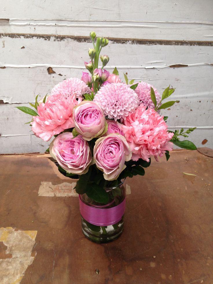 mixed pink roses and seasonal flowers in a keepsake vase
