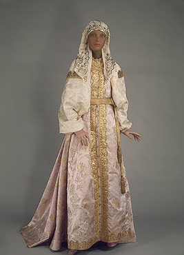 Festive Costume of a Cossack Woman   Ural Region, the city of Uralsk   Russia. Late 19th - early 20th century	  Satin, silk, calico, galloon, gilded thread, wire, crystal, silver and silver thread; embroidery. L.:sarafan 185, sash 280x4.5, headscarf 69x145 cm   Source of Entry:   Purchasing Commission of Experts of the State Hermitage Museum. 1993