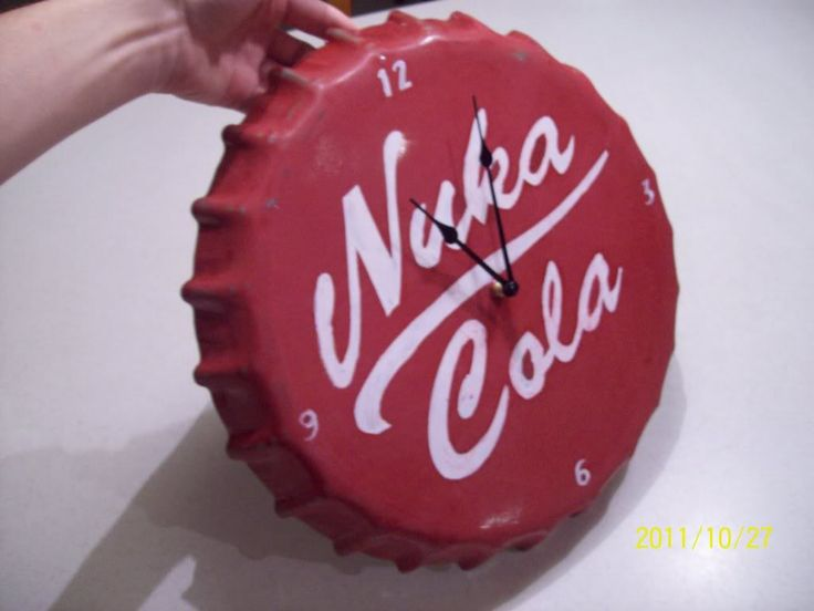 "This is a Fallout 3 inspired clock i just finished up. I found a bottlecap clock for sale at Hobby lobby that said ""MAN CAVE"" on it, but I figured I could repaint it to make it a little cooler."