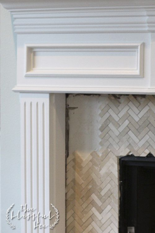 Herringbone tile around fireplace. Would also want at front entry.