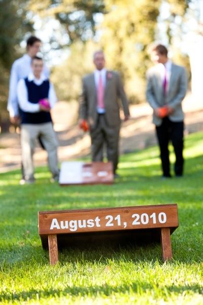cornhole wedding date..under light area 4 posts