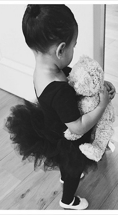 North West knows that the perfect ballerina outfit accoutrement is a Teddy bear.
