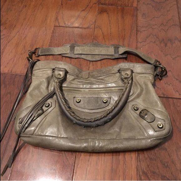 Balenciaga Gray Tan Taupe First Handbag 100% authentic Balenciaga first bag. I am only selling this because there is a slight smoke smell to it as I bought it secondhand. It is used and the handle is ripped and has a few bite marks in them. The handles have darkened and the back has some color transfer as well. It is still a great bag and has a lot of life left!!! Balenciaga Bags Satchels