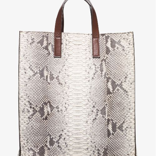 """Store Style #: 31S6PPRT3N -100% Python Leather -12""""W X 14.5""""H X 6.5""""D -4.5"""" Handle Drop -Interior: Open Pocket -Lining: 100% Goat Suede -Imported STYLE NOTES Exquisite python meets a sharp, streamlined silhouette with our Prescott tote. Its unlined interior gives it an exceptionally lightweight feel, while smooth leather handles offer a classic finish. An exotic design with a spacious interior, it promises polish from day to night."""