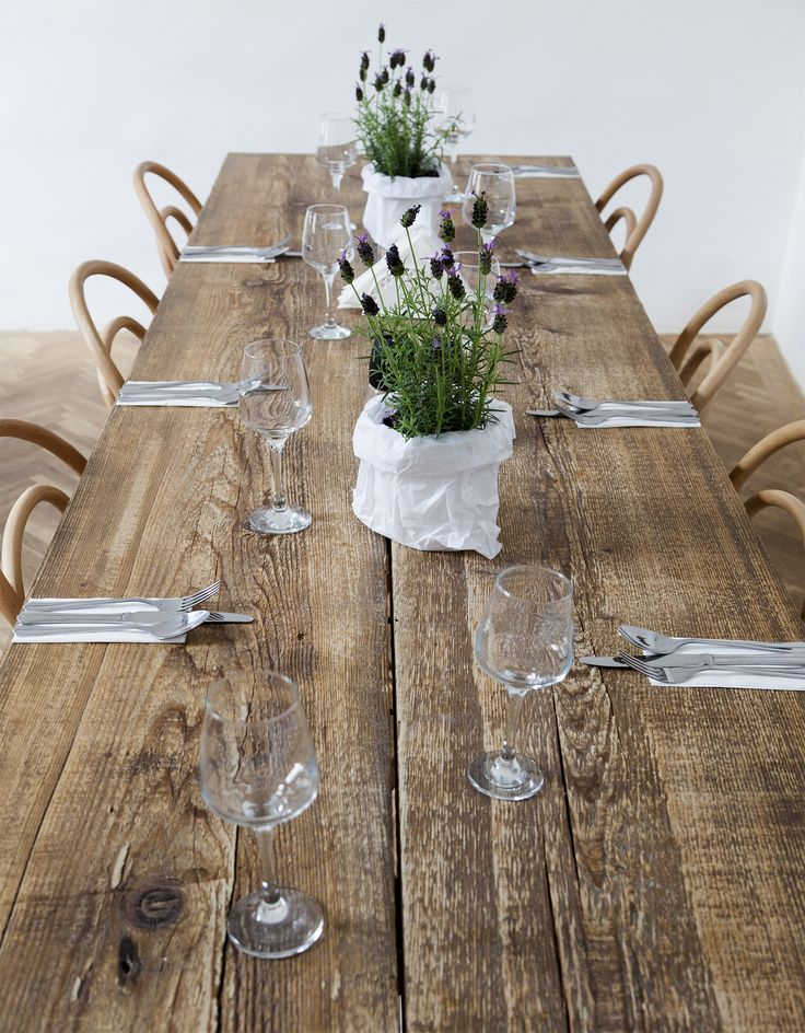 Long, rough reclaimed wood table. Lavander as summer table decoration. Thonet chairs. Photo credits, Emi Gheorghe.