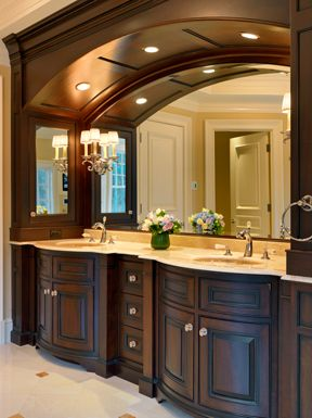 FORMAL BALANCE  - Formal balance is when a room is symmetrical, objects are arranged to make a center point.   - I chose this his and her sink bathroom because both sink sides are identical. The sinks are symmetrical and create a traditional feel.