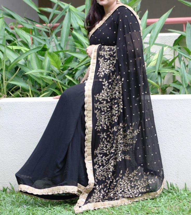 Black georgette saree with gold zari work