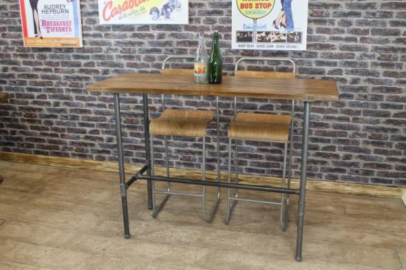 These tall bar tables are part of a new range of industrial style restaurant, cafe and dining tables that we are now supplying. The tops are made from reclaimed pine, and the bases are made from industrial strength steel pipe work, with cast iron fittings. - See more at: http://www.peppermillantiques.com/tall-bar-tables-poser-tables-steel-base/#sthash.SIQNJpKV.dpuf