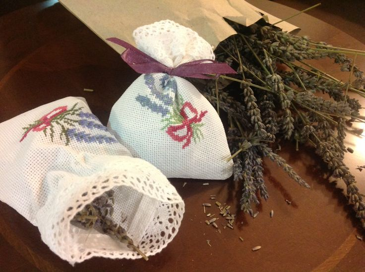 LAVENDER SACHETS    Great to scent your drawers and keep insects away. you can also put them in a chest or your car.  I've filled mine sachets with dried lavender from my garden, cross stitched lavender pattern and tied with a little bow.
