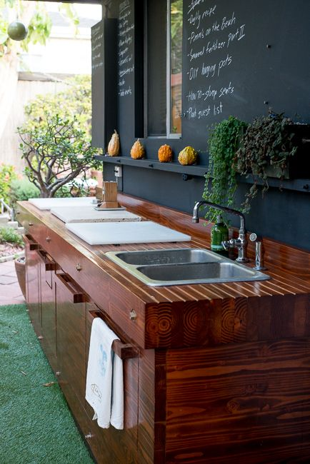 Outdoor kitchen with chalkboard wall (decorated with gourds for fall) | The Horticult