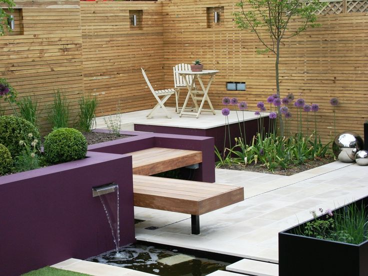 Natural Indian Sandstone Paving - Polished Mint. Stunning purple accents warmed with wood.