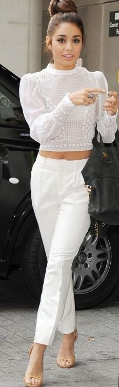 We hear from the street that white-on-white outfits will be white-hot this spring.  This outfit hits all points: lace, crop top, ankle pants, all in summer white. #White #Style #Fashion