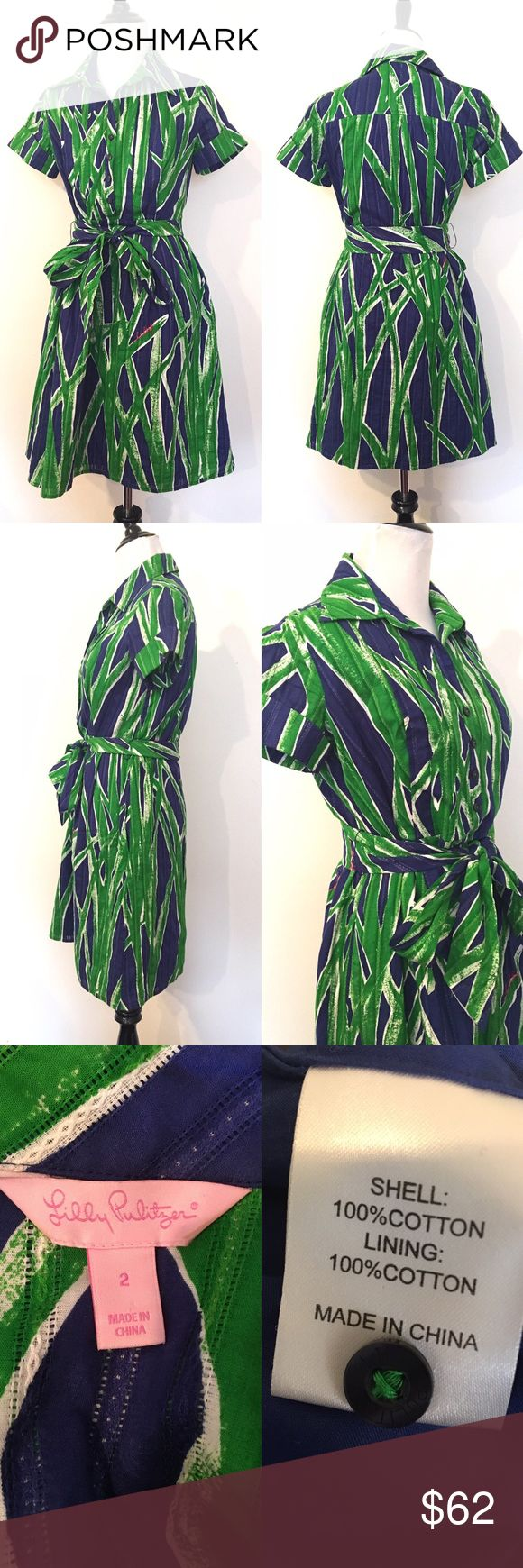 """Lilly Pulitzer Sz 2 Faux Wrap dress button down Gorgeous !!! What a find !!!!  There is just not enough room in my little  NYC closet!   The fabric is gorgeous - there is a lacy look to it with strips of little eyelet pattern up and down (hard to explain! Look at pics :)  Button down to the chest level  Large pointed collar  Full skirt  The word Lilly is printed in pink in the fabric   Measurements:  Sleeves : 6""""  Shoulders 4""""  Pit to pit : 19""""  Waist : 15.5""""  Collar to hem: 36""""   Any…"""