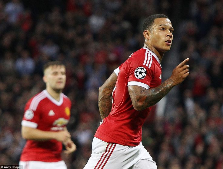 Memphis Depay celebrates putting Manchester United into a 2-1 lead in their Champions Leag...
