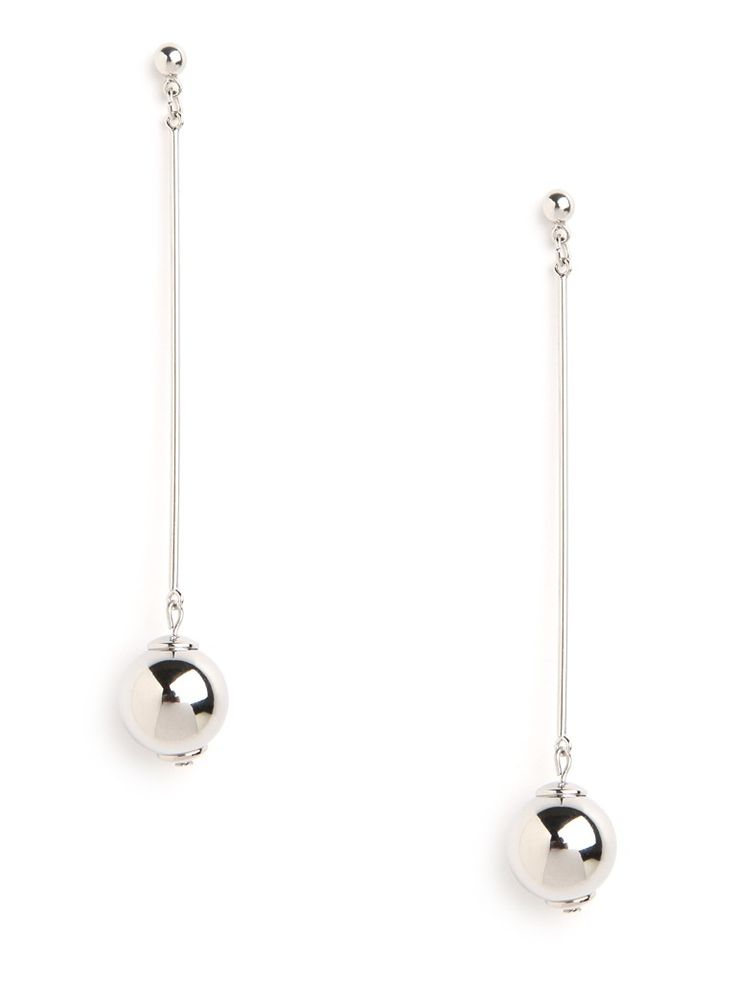 These striking earrings work a street-chic punk edge that's also supremely playful, too. Just check out those long swinging shot-put pendants that are bound to turn heads.  This is part of the BaubleBar + Nina Garcia Minimalism Collection