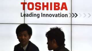 Image copyright                  AFP               Toshiba's management has come under fierce criticism from shareholders, despite investors approving plans to sell its valuable memory chip unit. The company needs money to plug a gaping hole at its US nuclear unit...